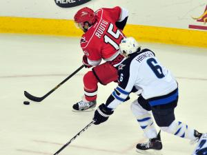 Tuomo Ruutu (15) skates with the puck during the Carolina Hurricanes vs. Winnipeg Jets NHL hockey game in Raleigh, N.C. Friday, March 30, 2012.