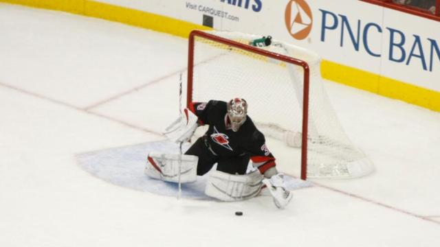 Cam Ward (30) collects the puck during the Panthers vs. Hurricanes game on March 2, 2013 in Raleigh, NC.