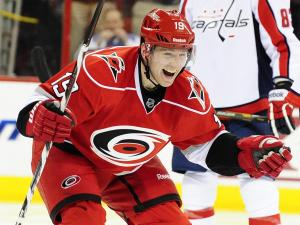 Jiri Tlusty (19) celebrates after scroing his third goal during the Carolina Hurricanes vs. Washington Capitals NHL hockey game, Tuesday, April 2, 2013 in Raleigh, NC.
