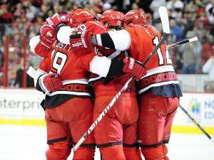 The Carolina Hurricanes celebrate after a first period goal during the Carolina Hurricanes vs. Washington Capitals NHL hockey game, Tuesday, April 2, 2013 in Raleigh, NC.