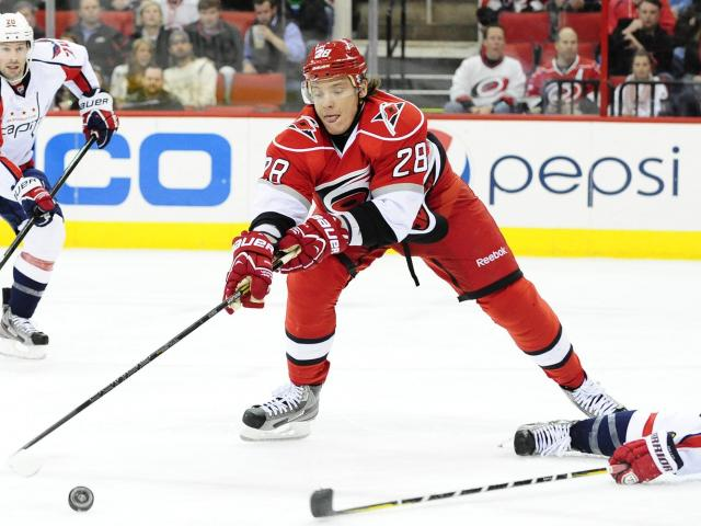 Alexander Semin (28) reaches for the puck during the Carolina Hurricanes vs. Washington Capitals NHL hockey game, Tuesday, April 2, 2013 in Raleigh, NC. <br/>Photographer: Will Bratton