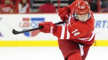 Red Wings spoil opener for Canes with 3-2 OT win