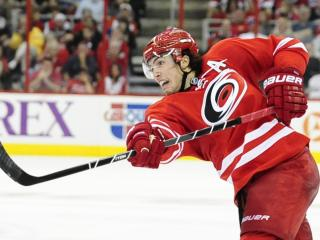 Justin Faulk (27) takes a shot during play at the PNC Center between the the Carolina Hurricanes and the Detroit Red Wings on October 4, 2013 in Raleigh, NC.