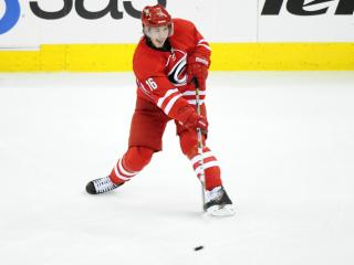 Elias Lindholm (16) takes a shot during play at the PNC Center between the the Carolina Hurricanes and the Detroit Red Wings on October 4, 2013 in Raleigh, NC.