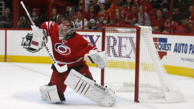 Anton Khudobin (31) makes a save during the Flyers vs. Hurricanes game on October 6, 2013 in Raleigh, NC.