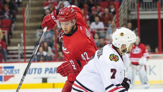 Carolina Hurricanes center Brett Sutter (42) moves the puck during tonights game.Hurricanes vs Blackhawks on October 15, 2013  in Raleigh North Carolina. (Photos By Anthony Barham)