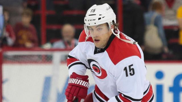 Carolina Hurricanes center Tuomo Ruutu (15) moves the puck down ice during the Hurricanes' 3-0 home loss to the Lightnings at PNC Arena on November 1, 2013 in Raleigh, NC (Photos By Anthony Barham)