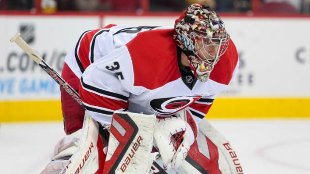Carolina Hurricanes goalie Justin Peters (35) sets up to block the goal during the Hurricanes' 3-0 home loss to the Lightnings at PNC Arena on November 1, 2013 in Raleigh, NC (Photos By Anthony Barham)