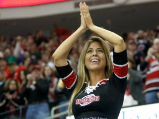 A member of the Storm Squad cheers after the Canes scored an equalizer goal. The Hurricanes hosted the Ducks on November 15, 2013  at the PNC Center in Raleigh, North Carolina.