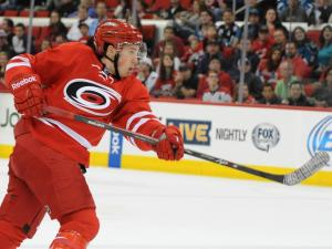 Jeff Skinner (53) takes a shot during action at PNC Arena between the Carolina Hurricanes and the San Jose Sharks on December 6, 2013 in Raleigh, NC.  (Photo by: Will Bratton)