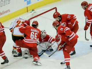 Carolina Hurricanes goalie Anton Khudobin (31) with a stop as Calgary defeats the Hurricanes 2 to 0 Monday night January 13, 2014 at PNC Arena.(Photo by WRAL Contributor Jack Tarr)