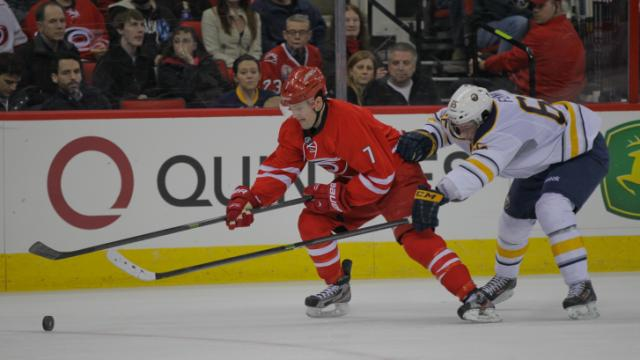 Carolina Hurricanes defenseman Ryan Murphy (7) with the puck as the Carolina Hurricanes defeat the Buffalo Sabres 4-2 Thursday night March 13, 2014 at PNC Arena. (Photo by Jack Tarr/WRAL contributor.)