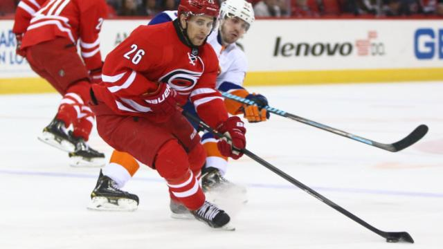 John-Michael Liles (26) slows down to control the puck. The Islanders defeated the Hurricanes 5-4 on March 25, 2014 at the PNC Arena in Raleigh, North Carolina. Photo by: Jerome Carpenter