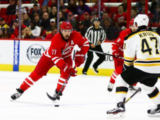 Justin Faulk (27) brings the puck up the ice. The Carolina Hurricanes defeated the Boston Bruins in overtime, by a score of 3-2, on December 23, 2016 in Raleigh, North Carolina. (Jerome Carpenter/WRAL Contributor)