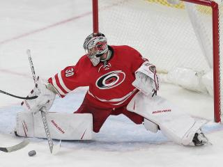 Cam Ward (30) of the Carolina Hurricanes. The Carolina Hurricanes host the Chicago Blackhawks on December 30, 2016 at PNC Arena. The Blackhawks scored first, but the Canes responded and took a gritty victory winning 3 to 2. (Chris Baird / WRAL Contributor).