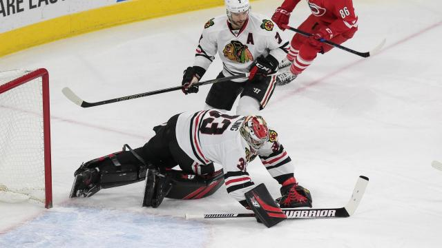 Scott Darling (33) of the Chicago Blackhawks makes a diving save. The Carolina Hurricanes host the Chicago Blackhawks on December 30, 2016 at PNC Arena. The Blackhawks scored first, but the Canes responded and took a gritty victory winning 3 to 2. (Chris Baird / WRAL Contributor).
