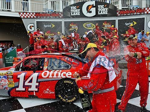 Aug. 10, 2009; Watkins Glen, NY, USA; NASCAR Sprint Cup Series driver Tony Stewart celebrates with crew members after winning the Heluva Good at the Glen at Watkins Glen International. The race is being run on Monday after being postponed due to rain. Mandatory Credit: Mark J. Rebilas-US PRESSWIRE