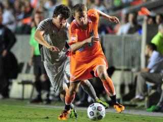 Brian Shriver (21) goes past a defender during the Carolina RailHawks vs. Atlanta Silverbacks NASL soccer game in Cary, N.C. Saturday April 14, 2012.