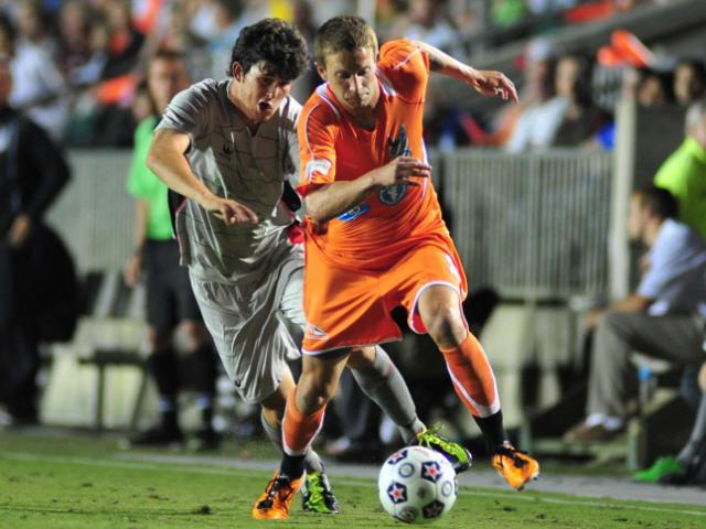 Brian Shriver (21) goes past a defender during the Carolina RailHawks vs. Atlanta Silverbacks NASL soccer game in Cary, N.C. Saturday April 14, 2012.<br/>Photographer: Will Bratton