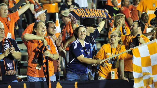 Carolina Railhawks fans celebrate the team's 2-0 victory over the L.A. Galaxy Wednesday night. The Lamar Hunt U.S. Open Cup game was played at WakeMed Soccer Park.