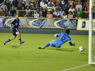 Railhawks forward Brian Shriver, left, watches his goal get past a diving L.A. Galaxy goalkeeper Brian Rowe. Carolina defeated the Galaxy 2-0.