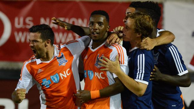 June 6, 2015: Nacho Novo and Ty Shipalane combined for the RailHawks only goal in a tie with Minnesota. Credit: Rob Kinnan-Carolina RailHawks.