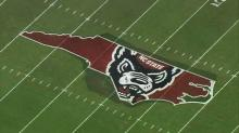 "IMAGE: UNC claims ""Our State"" at NC State midfield"