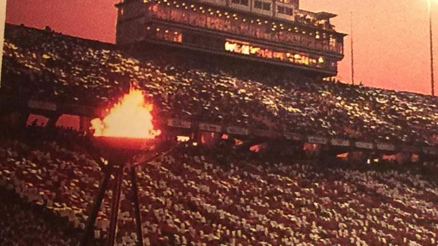 The Olympic Torch lights the flame at Carter-Finley Stadium in Raleigh during the U.S. Olympic Festival in 1987.